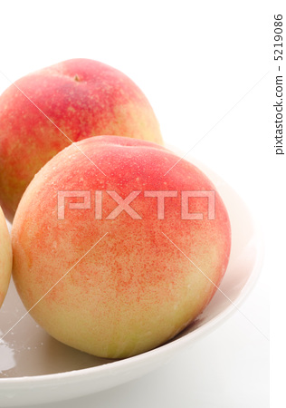 Peach fruit on two dishes 5219086
