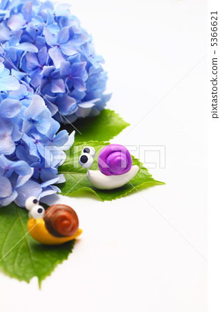 Two cute handmade snails and purple hydrangea (vertical) 5366621