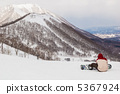 Snowboarders and snow mountains 5367924