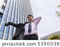 A businessman wearing a coat 5390038