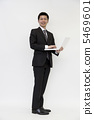 A young businessman with a laptop 5469601