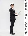 A businessman with a laptop computer 5469602