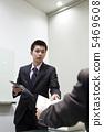A businessman hands the materials 5469608