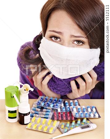 Girl having flu taking pills 5512111
