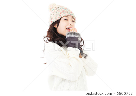 A woman in a sweater 5660752