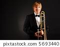 Female with trombone 5693440