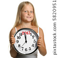 The girl hold in hands a big clock with figures 2013 5820951