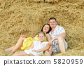 A young family, father, mother and daughter 5820959