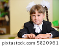 schoolchild with white bows and black suite 5820961
