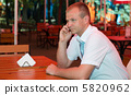 Young businessman speaks on a mobile phone 5820962
