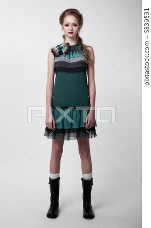 Fashion style - beautiful young girl posing in studio 5839531