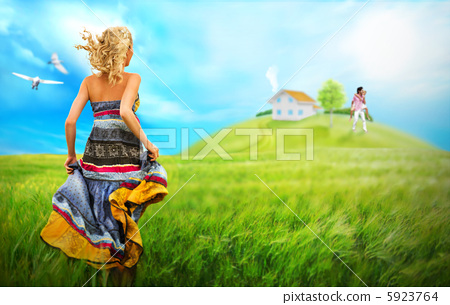 Young woman running across field to house and family of her drea 5923764