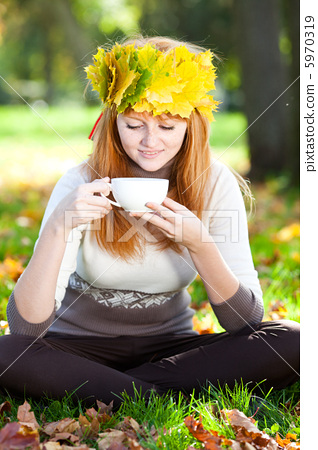young redhead teenager woman in a wreath of maple  5970319