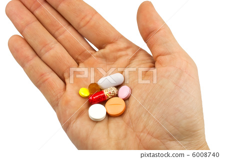 pills in hand isolated on white 6008740