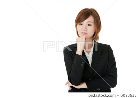Worried young business woman 6083635