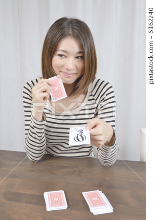 A woman holding a joker and holding it 6162240