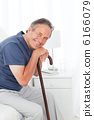 Retired man with his walking stick 6166079