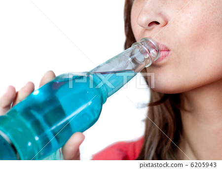 Cheerful woman drinking a blue beverage 6205943