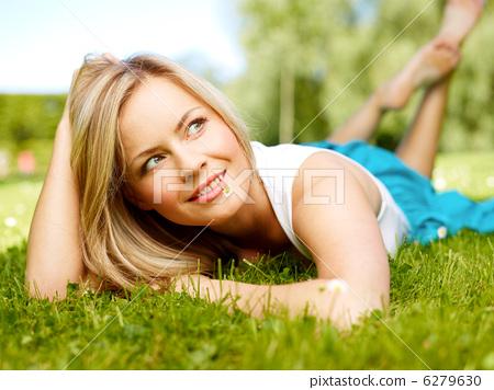 Girl in a grass (medium format image) 6279630