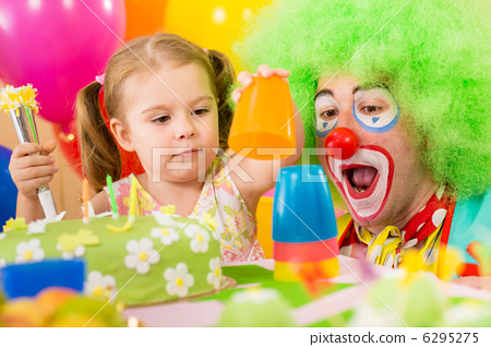 child girl playing with clown on birthday party 6295275