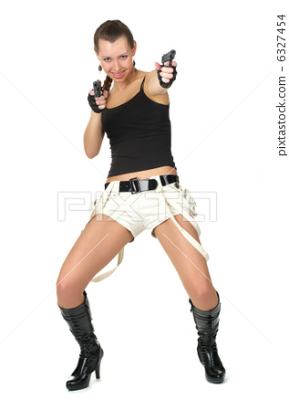 Attractive female with two handguns 6327454