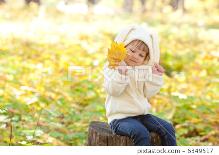 beautiful little girl in costume bunny in the autumn forest 6349517