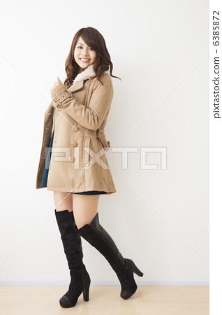 c47e8ec5550 Women in coat and knee high boots - Stock Photo [6385872] - PIXTA