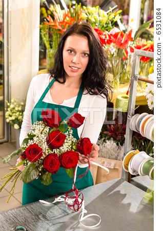 Stock Photo: Florist woman arranging flowers roses shop working