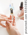 Women's wearing nail polish at the nail salon 6560885