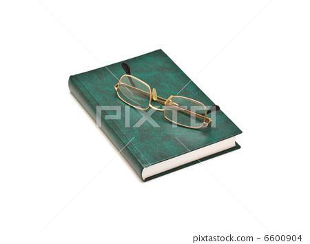 Green book and glasses, isolated on white background 6600904