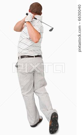 Rear view of golfer 6630040