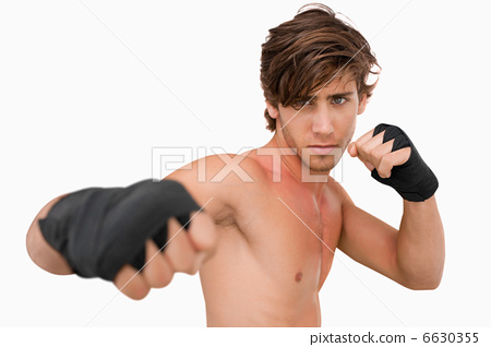 Stock Photo: Martial arts fighter attacking with his fist