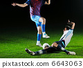 football players in competition for the ball 6643063