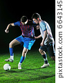 football players in competition for the ball 6643145
