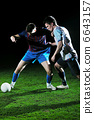 football players in competition for the ball 6643157