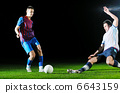football players in competition for the ball 6643159