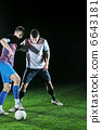 football players in competition for the ball 6643181