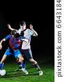 football players in competition for the ball 6643184
