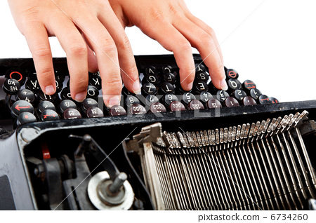 Female hands typing on the keyboard of the old mechanical typewr 6734260