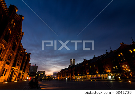 Evening view of red brick warehouse 6841729