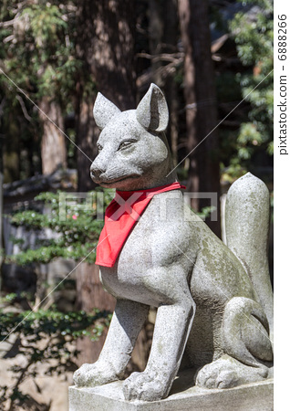 Stone statue of Toyokawa Inari fox - Stock Photo [6888266