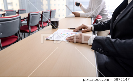 Men and women in the conference room 6972147