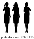 Silhouette of a female company worker who makes a phone call 6978336