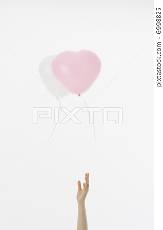 Heart balloons and hands 6998825