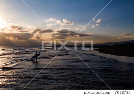A surfer in the sunset at Shonan Sukuma coast 7018786