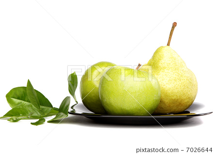 Fresh fruit. Apples and pears on a plate isolated over white bac 7026644
