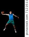 Basketball player with a ball 7121611
