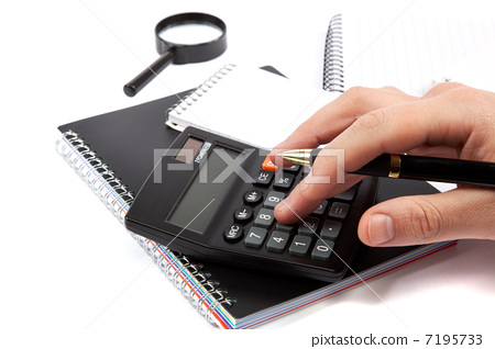 Hands holding the handle and pressing calculator buttons over do 7195733