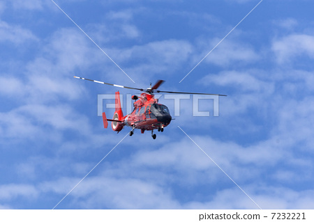 Red rescue helicopter moving in blue sky 7232221