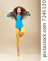 Aerobics. Gymnastics. Shapely Woman in Sportswear and Woolen Gaiters. Vitality 7245130